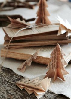 ornaments made from old book pages...love them a great way to save money and save the plant small and simple, step by step....love the earth!