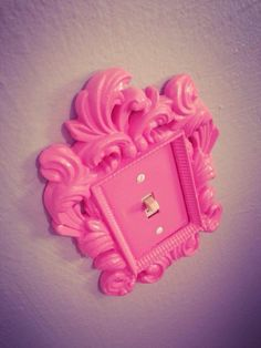 Glue an ornate picture frame to a plain, builder-grade light switch plate; paint them both one color; voila! DIY light switch plate!