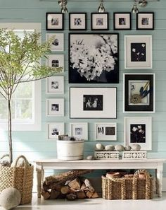 Light colored wall with black and white photos.