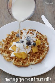 Make your favorite waffles then top it with peaches, some brown sugar and cream  - recipe on NoBiggie.net