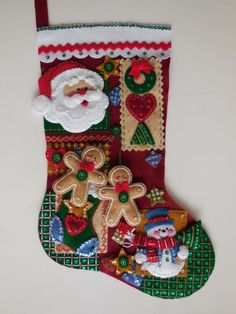 Finished Christmas Stocking - Christmas Patchwork.   La forma de esta bota me encanta