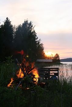 Midsummer's Eve - In Finland the sun doesn't go down on Midsummer's Eve, and the Finns burn fires through the evening... and sing and are awake the whole night and make love and grill sausages in the last heat of the fire in the early morning before going to sauna and swimming...