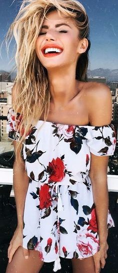 summer mood beauty girl wearing a floral playsuit