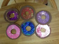 Bakery dramatic play:  doughnuts made out of craft foam and glitter for sprinkles.