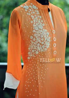 Two layer georgette Kurti with pearl handwork on one side. Team it up with white leggings to look cool and beautiful :)
