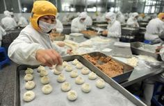 An employee makes stuffed steamed buns at a food factory in Yangzhou, Jiangsu province January 8, 20... - REUTERS/Stringer