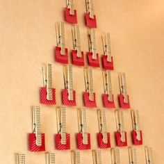 Instructions for a homemade advent calendar made of magnetic clothes pins and lots of love notes.