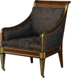 A Magnificent Russian Regency, mahogany, brass mounted and upholstered easy arm chair, the shaped and rectangular back support and arm rests, swept back and scrolled, elaborately inset with gilded decorative molding and borders, the deep, upholstered seat frame similarly shaped and mounted; on four square tapering and molded legs, terminating in brass toes and casters all elaborately inset with similar gilded moldings and mounts. Russian, circa 1825.