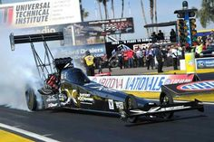 Spencer Massey drives Schumacher Battery Charger and Fram Top fuel Dragster