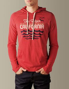 Lean back and ride the wave in this cozy hoodie by True Religion. The Mens Wave Runner Jersey Pullover Hoodie features a retro graphic design that...