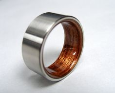 "Chris said he liked this ring...""bad ass"" Bent Wood and Titanium Wedding Ring -- Rosewood Interior with Satin finished Titanium Exterior @jessi ellingson"
