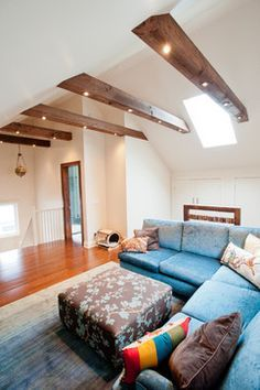 Installing can lighting in ceiling beams on vaulted ceiling. Attic Conversion contemporary family room by Carick Home Improvements
