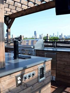 Kitchen, Natural Wooden Outdoor Kitchen Design With Pergola Also Gray Granite Countertops Also Stainless Grill Appliance Also Stainless Waste Bin Cabinet Also Brown Floorboard: Outdoor Kitchens Designs and Ideas On The Summer