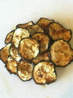Zucchini Chips - P3 if you're being strict. Pretty minimal olive oil for other phases though.  zucchini olive oil spray seasoning (I used sea salt & paprika this time)  Slice zucchini evenly. Spread out on parchment lined pan. Spray lightly with olive oil and season lightly. (go light on the seasoning as they really intensify as they shrink.)  Bake at 225 until they are crisp. I usually start at 45 min and turn the pan in the oven after that and keep an eye on them. This batch took 1 1/2 hrs