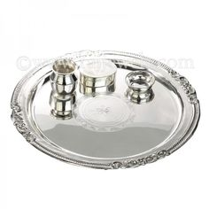 Pure 925 #silver #poojathali set, consists of a silver bowl, oval shape silver kumkum box & silver glass- your complete silverware ensemble of pooja items for the festive occasion of #Diwali. The thali has a pleasing design in the centre and trim. - See more at: https://www.rajjewels.com/silver-pooja-thali-set.html#sthash.koaC7HZ1.dpuf