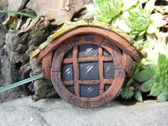 Fairy window Etsy listing at https://www.etsy.com/listing/77533084/round-fairy-window-with-shingles