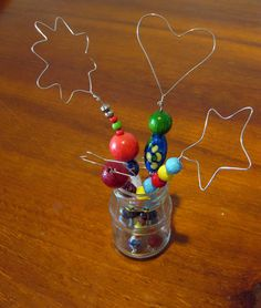 Make a bubble wand - looks like a fun year-end gift for the kids -- hey, they could even make some of it for themselves!! And send the bubble recipe home with the kids so that they can make some more! Get those beads out one more time.......