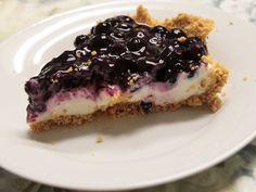 Blueberry pie with cream cheese and graham cracker crust. I'll be using huckleberries instead. Yum!