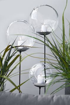 "FLAMMA VOTIVE STAKES. These oversized glass orbs create a magical glow when lit with a votive candle. Stake them along a pathway to create a romantic walkway or in planters to set the mood in an outdoor seating area. They are best used with sand to create an even surface for the candle. Two sizes 6""dia with 24""stake, 8""dia with 36""stake."