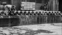 Prohibition, 1925 In public show of prohibition, barrels of beer are dumped at an army base in Brooklyn into the New York City harbor. Vintage b&w NYC photo. Nagasaki, Hiroshima, Fukushima, Roaring Twenties, The Twenties, La Prohibition, Vietnam, Man Cave Art, Bar Cart Decor
