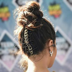 Shay Mitchell - Hair jewelry and baubles have always been around, but pierced braids have not. Many credit Shay's hairstylist, Chris Appleton, for bringing this bold hair trend into the public eye.Watch us try it ourselves here.