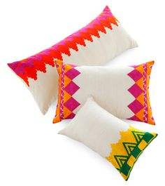 """Photo: Geoffrey Sokol Manglam Arts has combined traditional Rabat embroidery with the vibrant colors of Rajasthan for its Moroccan cushions. The silk covers are edged in a variety of geometric borders. The cushions are, from top, $125 for the 15"""" x 27"""" size, $95 for the 12"""" x 19"""", and $75 for the 9"""" x 15"""". 212-473-3000"""