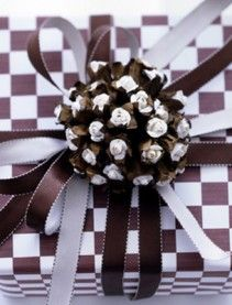 Neat gift wrapping design with the pinecone painted to compliment the paper❣ Carolyne Roehm