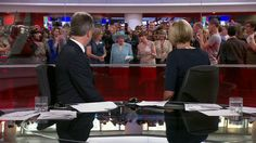 BBC News - Queen officially opens BBC's new Broadcasting House building and wanders into shot during a news broadcast!
