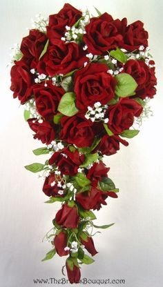 The rich texture of these luxurious red silk roses is utterly captivating. The design is simple but still quite elegant. Abundant red silk roses and deep green foliage. The red silk roses have a reali
