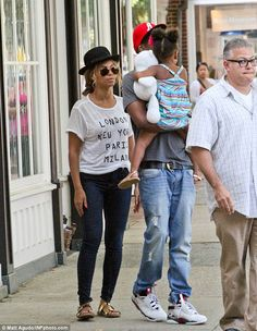 What a cutie: Blue ivy carried a white stuffed bear as she snuggled in her dad's arms, whi...