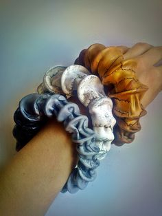 organic polymer clay bracelets by Sona Grigoryan.... just very interesting design.