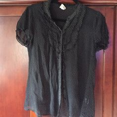 Black sheer top Short sleeve black sheer blouse with white Polk a dots. The front is a button up with ruffling up the front and on the sleeves Merona Tops Blouses