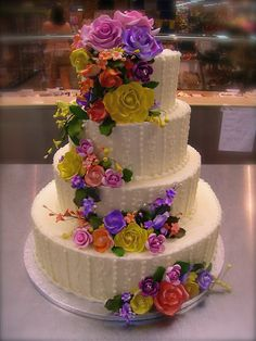 wedding cakes with cascading colorful flowers | Pin it Like Image