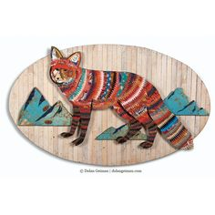 Eclectic fox artwork features a red fox with mountain backdrop constructed from hand-cut vintage tin and other metal on reclaimed wood background. Oval shaped.