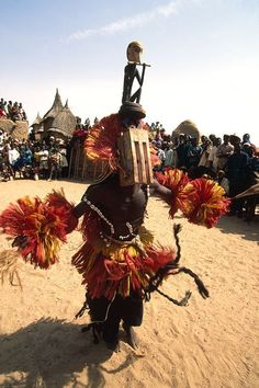 """Africa   """"Black monkey"""" masquerader dancing during a Dama (end of mourning). Tireli village, Dogon Country, Mali   ©Michel Renaudeau"""