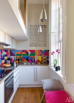 Color accents and a wall graphic.