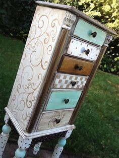 Hand painted chest of drawers using a variety of patterns with gold paint, aqua stain and a lot of ingenuity to achieve an eclectic, whimsical look.