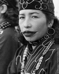 The indigenous Ainu women of the islands of Northern Japan still follow ancient traditions in self presentation; tattooing their lips in an exaggerated shape. - Vestoj