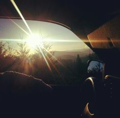 Driving/country/mountain/trees/sunshine