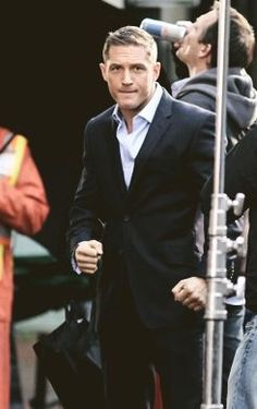 """Reese Witherspoon and Tom Hardy film their film """"This Means War"""" in Vancouver, Canada. Between takes, Tom let Reese listen to his 29 Hello Gorgeous, Most Beautiful Man, Beautiful People, Tom Hardy Hot, Tommy Boy, Thing 1, Perfect Man, Perfect Husband, Celebs"""