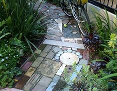 salvaged materials -garden path - how much stuff do we throw in the recycle bin that could be used for this?!