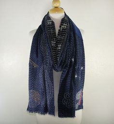 If casual elegance is your look, this is your scarf. Its medium-weight vintage, indigo-dyed fabric with Japanese sashiko accents. The base fabric is