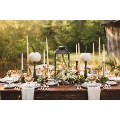 Brides.com: . Pumpkins perched on taper candlesticks give the fruit height and prominence in this garden elegance tablescape. Miniature pumpkins interspersed throughout the setting bring the look full circle.