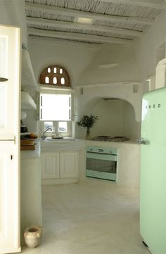 Possibly the best white kitchen ever. That fridge just pushes everything over the edge. So great!