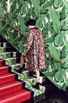 small red leaf print fabric against oversized green leaf wallpaper, green geometric and red plain runner