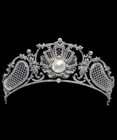 A Belle Epoque platinum, diamond and pearl tiara, English or French, circa 1907.