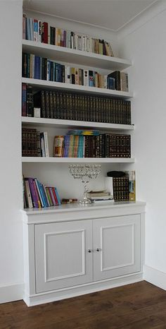 Fitted wardrobes and bookcases in London, shelving and cupboards.