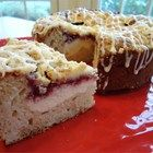 Raspberry Cream Cheese Coffee Cake - This is a wonderful alternative to those standard cinnamon-walnut-streusel coffee cake recipes with the lovely addition of raspberry preserves.