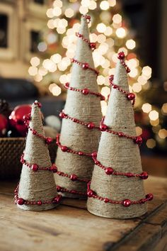 DIY Twine & Bead Wrapped Holiday Trees.  Options: Make a paper cone, add 50% glue/50% water to a small spray bottle and spray yarn, ribbon, or felt to the cone. Allow to dry then decorate with all sorts of things. I would avoid the pins if you have small children in the house and just use pure glue to decorate. Fun for kids.