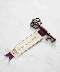 key with escort card to table & is also a bottle opener! soo getting these